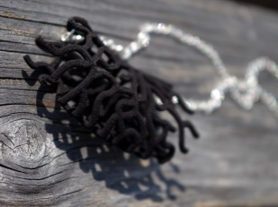 Floating Coral necklace in black