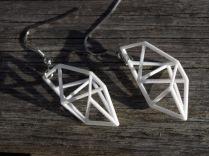 geometric earrings in white